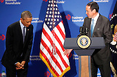 United States President Barack Obama, left, is introduced by Randall Stephenson, Chairman, Business Roundtable and Chairman and CEO of AT&T, before delivering remarks to members of the Business Roundtable and answering questions from a group of business leaders at the quarterly meeting of the Business Roundtable at the Business Roundtable Headquarters in Washington, DC on December 3, 2014. <br /> Credit: Aude Guerrucci / Pool via CNP