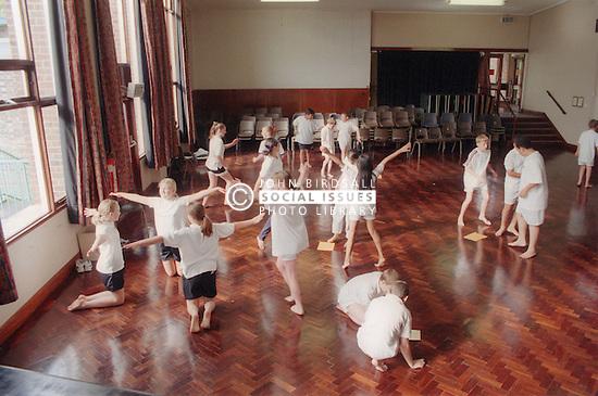Pupils in gym class doing activities,