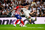 Luka Modric of Real Madrid (R) fights for the ball with Jose Maria Gimenez of Atletico de Madrid (L) during their La Liga  2018-19 match between Real Madrid CF and Atletico de Madrid at Santiago Bernabeu on September 29 2018 in Madrid, Spain. Photo by Diego Souto / Power Sport Images
