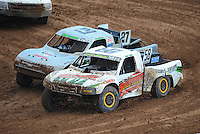 Mar. 19, 2011; Chandler, AZ, USA;  LOORRS pro two driver Jesse James and Scott Martenson in turn 3 during round one at Firebird International Raceway. Mandatory Credit: Mark J. Rebilas-US PRESSWIRE