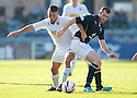 Morton's Dougie Imrie and Dundee's Craig Beattie challenge for the ball.