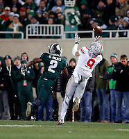 Ohio State Buckeyes wide receiver Devin Smith (9) makes a deep catch against Michigan State Spartans cornerback Darian Hicks (2) during the 2nd quarter at Spartan Stadium in East Lansing, Michigan on November 8, 2014.  (Dispatch photo by Kyle Robertson)