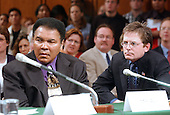 Mohammad Ali, left and Michael J. Fox, right, testify during the United States Senate Appropriations Subcommittee on Labor and HHS hearing on Parkinson's Disease in Washington, DC on May 22, 2002. Both the Champ and Mr. Fox advocated for increased funding to the National Institutes of Health (NIH) for Parkinson's research.<br /> Credit: Ron Sachs / CNP