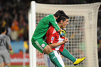 Oscar Cardozo celebrates his penalty kick conversion, which earned Paraguay advancement into the quarterfinals.Japan and Paraguay played in the second round of the 2010 FIFA World Cup in Loftus Versfeld Stadium, in Pretoria, South Africa, June 29th. After regulation and extra time ended 0-0, Paraguay advanced to the quarterfinals, 5-3, in a penalty-kick shootout.