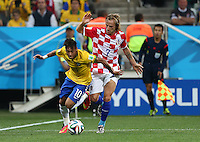 Neymar of Brazil and Ivan Rakitic of Croatia in action