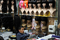 CHINA, Guangzhou, Kanton, shop for artificial and natural hair and wigs which are exported to africa, the natural hair comes from headshavings at Hindu temples in India