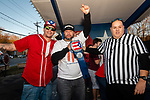 WATERBURY, CT. 12 January 2020-011220BS19 - Jose Rivera, center, holds the championship belt in his hands as he stands with referee Ivan Villa, right, and co-owner of the Little Puerto Rico Restaurant Rubio Aviles, left, after eating a Baked Potato the fastest and be declared the winner of the baked potato eating contest at the Little Puerto Rico Restaurant on Sunday. Jose won $50 to go along with his belt. Bill Shettle Republican-American