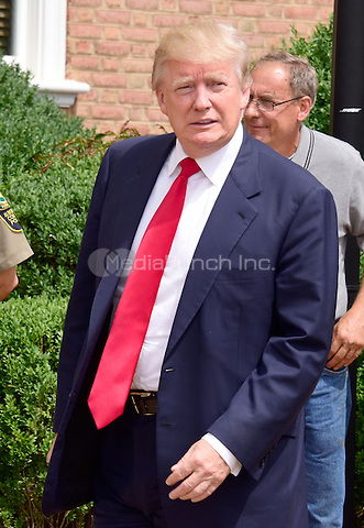 Donald Trump, a candidate for the 2016 Republican nomination for President of the United States, appears at the ribbon cutting for the Albemarle Estate at the Trump Winery in Charlottesville, Virginia on Tuesday, July 14, 2015. <br /> Credit: Ron Sachs / CNP/MediaPunch<br /> <br /> (RESTRICTION: NO New York or New Jersey Newspapers or newspapers within a 75 mile radius of New York City)