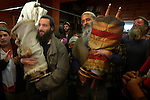 Avri Ran, second right, carries a new Torah scroll into the synagogue of the unauthorized Israeli outpost of Givot Olam, West Bank.<br />