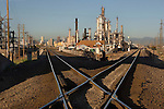 Oil refinery with the Denver skyline, Commerce City, Colorado. John offers private photo tours of Denver, Boulder and Rocky Mountain National Park. .  John leads private photo tours in Boulder and throughout Colorado. Year-round Colorado photo tours. .  John offers private photo tours in Denver, Boulder and throughout Colorado. Year-round Colorado photo tours.
