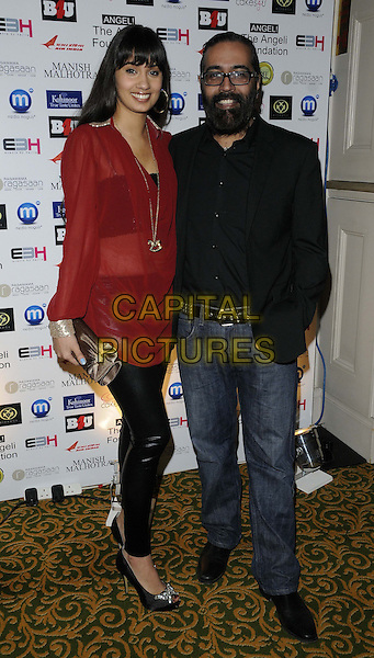 Sunny & Shay.attended the Manish Malhotra Fashion Extravaganza, Grosvenor House Hotel, Park Lane, London, England..February 23rd, 2013.full length red black sheer top leather trousers jeans denim beard facial hair.CAP/CAN.©Can Nguyen/Capital Pictures.