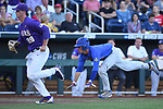 OMAHA, NE - JUNE 26: David Guthrie (5) of the University of Florida dives towards home plate for the first run of the game against Louisiana State University during the Division I Men's Baseball Championship held at TD Ameritrade Park on June 26, 2017 in Omaha, Nebraska. The University of Florida defeated Louisiana State University 4-3 in game one of the best of three series. (Photo by Jamie Schwaberow/NCAA Photos via Getty Images)