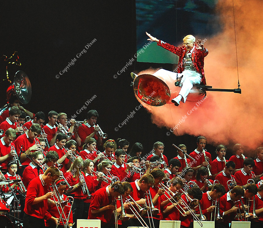 Band director Michael Leckrone flies in on a smoking tuba during the UW marching band performance at the Kohl Center in Madison, Wisconsin