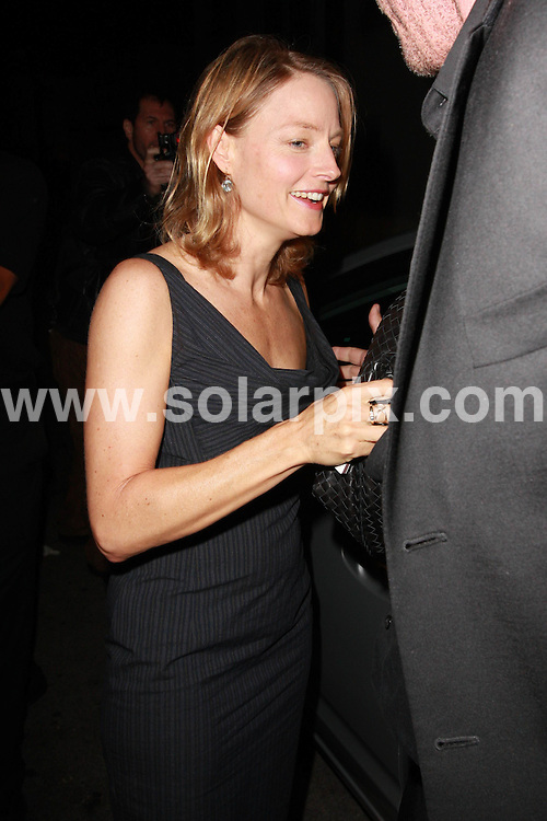 **ALL ROUND PICTURES FROM SOLARPIX.COM**.**WORLDWIDE SYNDICATION RIGHTS**.**NO PUBLICATION IN AUSTRALIA, NEW ZEALAND, DENMARK, GERMANY OR USA**.Jodie Foster was inside Koi Restaurant and went back and forth from the front entrance to the back exit trying to avoid paparazzi. She finally decided to face the music via the back exit and tries to shield her face from pictures.  She eventually accepts the situation and removes the designer handbag from her face before leaving Koi Restaurant, Hollywood, California, USA. 23rd September 2008..JOB REF: 7443 LAP (JS)      DATE: 23_09_2008.**MUST CREDIT SOLARPIX.COM OR DOUBLE FEE WILL BE CHARGED* *UNDER NO CIRCUMSTANCES IS THIS IMAGE TO BE REPRODUCED FOR ANY ONLINE EDITION WITHOUT PRIOR PERMISSION*