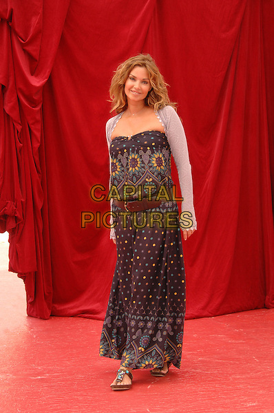 INGRID CHAUVIN .Attends a photocall  on the fifth day of the 2008 Monte Carlo Television Festival held at Grimaldi Forum, Monte Carlo, Principality of Monaco, June 12th 2008..full length black print dress grey shrug belt sandals .CAP/TTL .©TTL/Capital Pictures