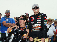 Sept. 30, 2012; Madison, IL, USA: NHRA pro stock driver Erica Enders (right) with Kyle Keck after winning the Midwest Nationals at Gateway Motorsports Park. Mandatory Credit: Mark J. Rebilas-