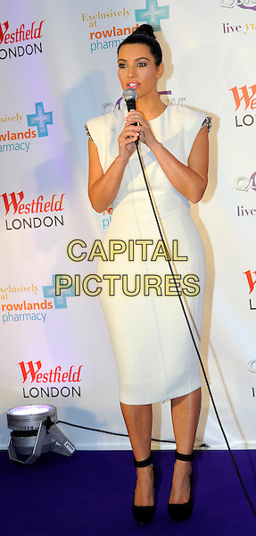 Kim Kardashian .celebrates the launch of her weight management product, QuickTrim at Westfield, Shepherds Bush, London, England, UK, May 19, 2012,.photocall full length white dress microphone speaking black ankle strap shoes .CAP/CJ.©Chris Joseph/Capital Pictures.