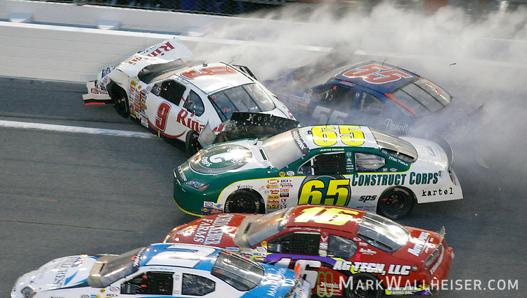 Justin Marks (65), Justin Allgaier (16) and Michael McDowell (2) try to slip past Tim Russell (9) when he and Damon Lusk (55) collide late in the ARCA RE/MAX 200 at Dayton International Speedway in Daytona Beach, Florida  February 10, 2007.    (Mark Wallheiser/TallahasseeStock.com)