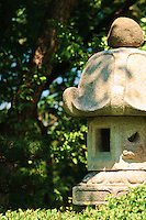 Stone lantern in the Ordway Japanese garden at the Marjorie McNeely Conservatory grounds of Como Park...The Japanese Garden opened in 1979 with funds donated by the family of Mrs. John G. Ordway. Mr. Masami Matsuda, a ninth-generation Master Gardener, designed the garden in the chisen-kaiya (strolling pond) style as a gift from Sister City Nagasaki. In 1990-1991, Matsuda supervised a complete renovation of the site, adding a teahouse and roji (tea garden). The Garden stays true to its Japanese traditions, using the elements of rock, water and plants to create a tranquil environment that guests are invited to experience from many angles...The Como Ordway Memorial Japanese Garden is the second Japanese garden to grace Como Park. The first was created in 1904 and disappeared from the Park Commission reports in 1909. The four white granite lanterns in the current garden are originals of the 1904 tea garden.