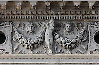 Sculpted frieze of putti above the first floor Ionic arcade of the Biblioteca Nazionale Marciana, or National Library of St Mark's, built in Renaissance style in 1537-53 by Jacopo Sansovino, then extended by Vincenzo Scamozzi in 1588, on the Piazzetta San Marco, between the Piazza San Marco and the Venetian lagoon, Venice, Italy. The columns are topped with Ionic capitals and the spandrel figures are angels in classical or all'antica style, and above, puttis hold decorative garlands, with classical masks. The 2-storey building is lined with a Doric arcade on the ground floor and Ionic arcade on the first floor, with sculptural decoration and a line of rooftop statues. The library houses an important collection of classical, Oriental and medieval codices and manuscripts. The historical centre of Venice is listed as a UNESCO World Heritage Site. Picture by Manuel Cohen