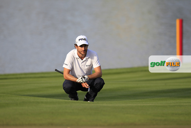 Alejandro Canizares (ESP) on the 5th green during Thursday's Round 1 of the Omega Dubai Desert Classic 2014 held at the Emirates Golf Club, Dubai. 30th January 2014.<br /> Picture: Eoin Clarke www.golffile.ie