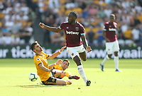 West Ham United's Michail Antonio is challenged by Wolverhampton Wanderers' Ruben Neves and Joao Moutinho<br /> <br /> Photographer Rob Newell/CameraSport<br /> <br /> The Premier League - West Ham United v Wolverhampton Wanderers - Saturday 1st September 2018 - London Stadium - London<br /> <br /> World Copyright © 2019 CameraSport. All rights reserved. 43 Linden Ave. Countesthorpe. Leicester. England. LE8 5PG - Tel: +44 (0) 116 277 4147 - admin@camerasport.com - www.camerasport.com