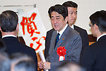 January 7, 2013, Tokyo, Japan - Japan's Prime Minister Shinzo Abe is welcomed at a new year party hosted by the Japanese Trade Union Confederation at a Tokyo hotel on Monday, January 7, 2013. Abe hoped from one party after another, delivering speeches of his economic recovery scenario. (Photo by AFLO)