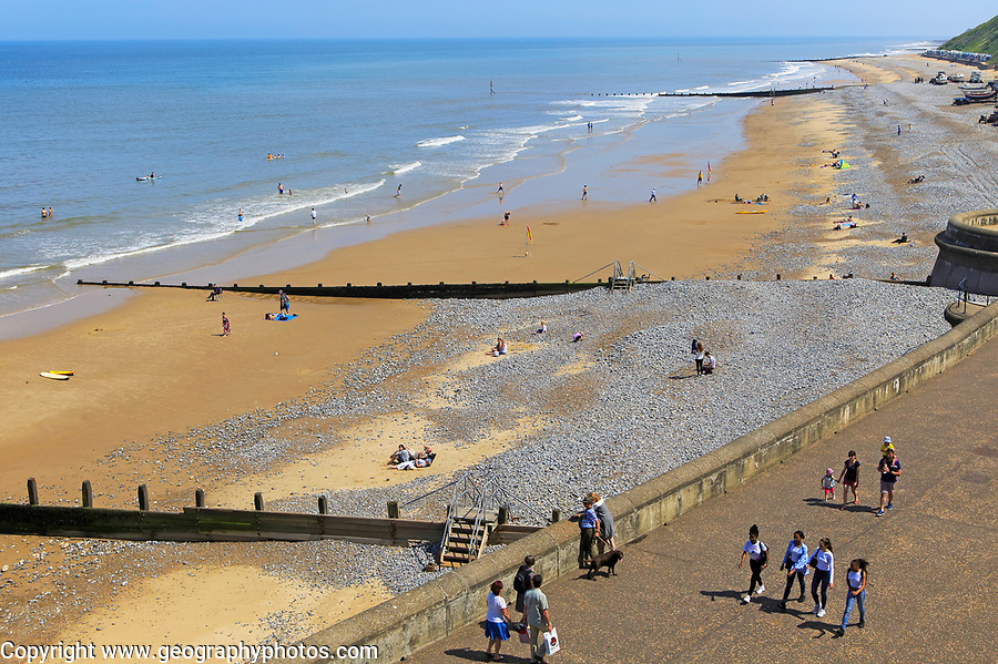 Sunny summer day sea sandy beach at  Cromer, Norfolk, England, UK