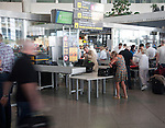 Security control baggage scanners in operation at Malaga airport, Spain