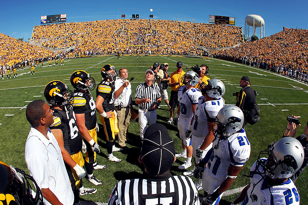 Glimmering in the sky, the coin is tossed to begin the 2010 Iowa Hawkeye football season against Eastern Illinois Saturday, September 4, 2010 at Kinnick Stadium in Iowa City, Iowa.