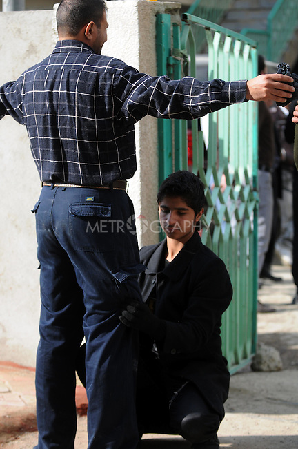 IRAQ, SULAIMANIYAH:  A security guard frisks a worshipper outside a Shia mosque...Around 500 hundred worshipers, many of them internally displaced Arabs, celebrated the Shia holiday of Ashura--the mourning of the death of the grandson of the Islamic prophet Mohammed.  ..Photo by Kamaran Najm/Metrography