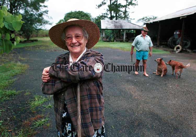 Maud Johnston, in the farmyard with her son Ducky at Tully, near Cairns in Northern Queensland, Australia. The Photo featured on The Scattering, Images Of Emigrants From An Irish County. .Photograph by John Kelly, courtesy of The Scattering book project.