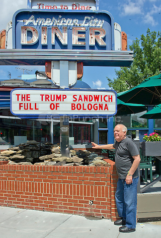 Jeffrey N. Gildenhorn, owner of the American City Diner, 5532 Connecticut Ave, NW; Washington, DC 20015, shows his sign promoting &quot;The Trump Sandwich: Full of Bologna&quot;, at the diner in Washington, DC on Tuesday, August 11, 2015.<br /> Credit: Ron Sachs / CNP/MediaPunch<br /> (RESTRICTION: NO New York or New Jersey Newspapers or newspapers within a 75 mile radius of New York City)