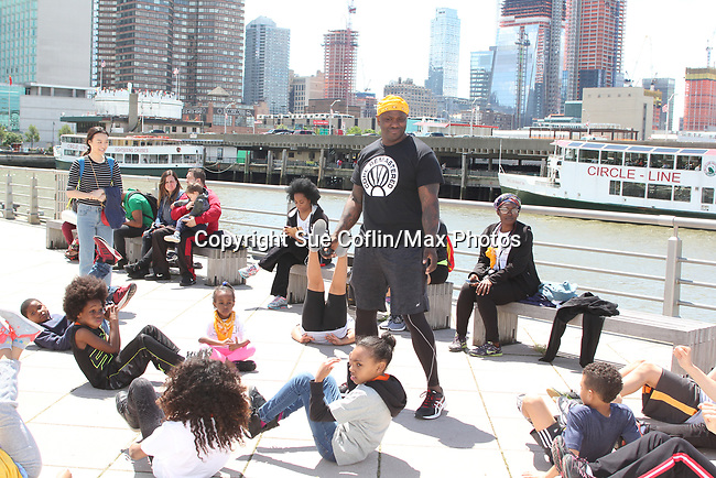 Rhonda Ross and son Raif at Boot Camp with Heart - Hearts of Gold 7th Annual Run/Walk for Kids with proceeds from this fun family event will change the futures of homeless mothers and their children on June 3, 2017 at Pier 84 Hudson Parks, New York City, New York. It supports Hearts of Gold Annual Back to School Programs. (Photo by Sue Coflin/Max Photos)