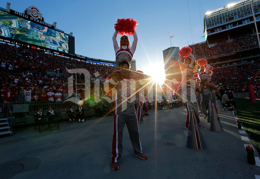 Ohio State Buckeyes cheerleaders perform during the third quarter of the NCAA football game against the Indiana Hoosiers at Ohio Stadium in Columbus on Oct. 8, 2016. (Adam Cairns / The Columbus Dispatch)