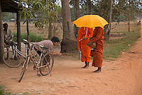 Buddhist Monks collecting Alms in the rural area south of Phnom Penh