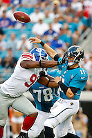 August 10, 2012:  Jacksonville Jaguars quarterback Blaine Gabbert (11) gets a hand to the helmet by New York Giants defensive end Justin Tuck (91) during first quarter preseason action between the New York Giants and the Jacksonville Jaguars at EverBank Field in Jacksonville, Florida.   Jacksonville defeated New York 32-31.........