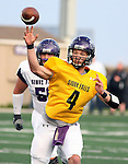 SIOUX FALLS, SD - APRIL 28: Quarterback Calvin Jacobson #4 of the University of Sioux Falls passes the ball to a receiver during the Cougars spring scrimmage Saturday evening at Bob Young Field. (Photo by Dave Eggen/Inertia)