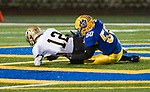 SEYMOUR, CT-112217JS03- Woodland's Tyler Bulinski (12) gets sacked for a loss by Seymour's Andrew Nimo-Sefah (50) during their game Wednesday at Seymour High School. Seymour defeated the Hawks  56-8. Jim Shannon Republican-American