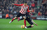 Filip Djuricic of Southampton is challenged by Liverpool's Joe Allen - Barclays Premier League - Southampton vs Liverpool - St Mary's Stadium - Southampton - England - 22nd February 2015 - Pic Robin Parker/Sportimage