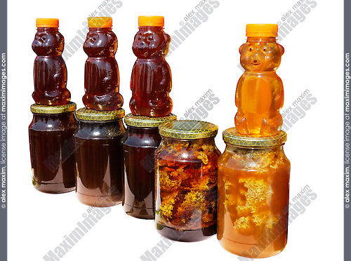Jars with amber-coloured fresh honey isolated silhouette with clipping path on white background