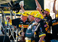 Sep 15, 2019; Mohnton, PA, USA; NHRA top fuel driver Richie Crampton (center) celebrates with team owner Connie Kalitta (left) and crew chief Kirk Elliott after winning the Reading Nationals at Maple Grove Raceway. Mandatory Credit: Mark J. Rebilas-USA TODAY Sports