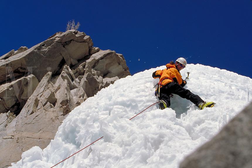 Man ice climbing in the Rocky Mountains, CO., Colorado.