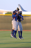 Shawon Dunston J (left), Albert Almora (center), Jorge Soler (right) of the 2012 AZL Cubs celebrate in the outfield after a 4-0 victory over the AZL Indians on August 1, 2012 in Goodyear, Arizona (Bill Mitchell)
