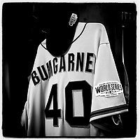 KANSAS CITY, MO - OCTOBER 22: Instagram of the San Francisco Giants pitcher Madison Bumganer's jersey hanging in his locker in the clubhouse before Game 2 of the World Series against the Kansas City Royals at Kauffman Stadium on October 22, 2014 in Kansas City, Missouri. Photo by Brad Mangin