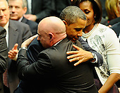 "United States President Barack Obama (L) hugs NASA astronaut Mark Kelly, husband of U.S. Representative Gabrielle Giffords (Democrat of Arizona), as he arrives to attend the event ""Together We Thrive: Tucson and America"" honoring the January 8 shooting victims at McKale Memorial Center on the University of Arizona campus on Wednesday, January 12, 2011 in Tucson, Arizona. The memorial service is in honor of victims of the mass shooting at a Safeway grocery store that killed six and injured at least 13 others, including U.S. Representative Gabrielle Giffords (Democrat of Arizona), who remains in critical condition after being shot in the head. Among those killed were U.S. District Judge John Roll, 63; Giffords' director of community outreach, Gabe Zimmerman, 30; and 9-year-old Christina Taylor Green.  .Credit: Kevork Djansezian / Pool via CNP"