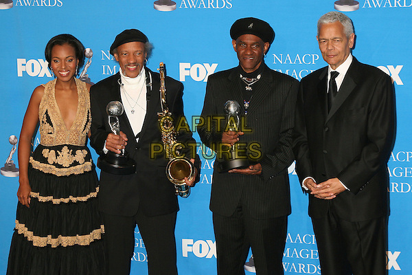 KERRY WASHINGTON, THE NEVILLE BROTHERS & JULIAN BOND.At the NAACP Image Awards, held at the The Shine Auditorium, Los Angeles, California, USA, .25 February 2006..half length press room gold and black dress saxophone.Ref: ADM/BP.www.capitalpictures.com.sales@capitalpictures.com.©Byron Purvis/AdMedia/Capital Pictures.