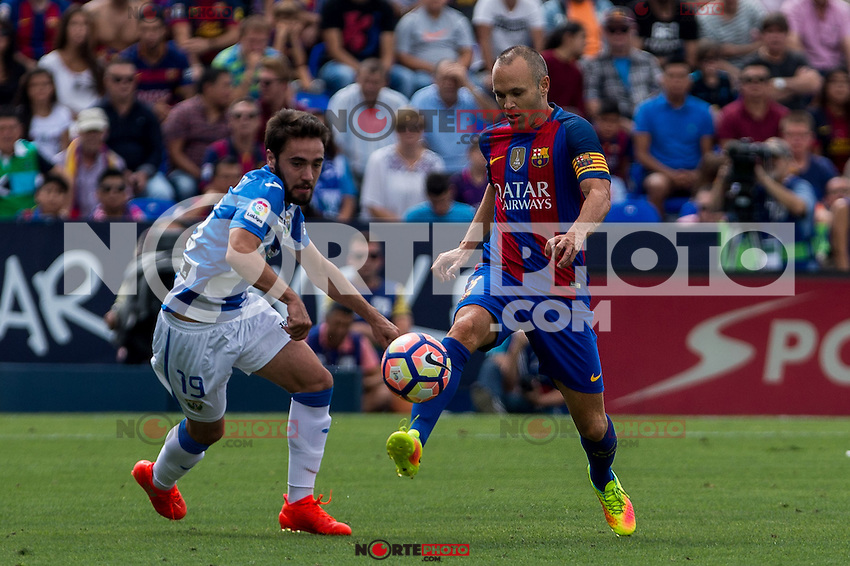 Club Deportivo Leganes's Unai Lopez and FC Barcelona's Andres Iniesta during the match of La Liga between Club Deportivo Leganes and Futbol Club Barcelona at Butarque Estadium in Leganes. September 17, 2016. (ALTERPHOTOS/Rodrigo Jimenez) /NORTEPHOTO
