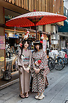 Tokyo, June 29 2013 -Two Japanese girls dressed with yukata in the Asakusa area.