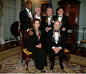 Recipients of the 1998 Kennedy Center Honors pose for a group picture December 5, 1998 at the Department of State in Washington, DC. (L-R Standing) Bill Cosby, John Kander, Fred Ebb and Willie Nelson, (L-R sitting) Shirley Temple Black and Andre Previn.  Each year the Kennedy Center Honors celebrate the lifetime achievements of America's greatest performing artists with a star-studded evening of song, dance, and tribute.   .Credit: George De Keerle- Pool / CNP